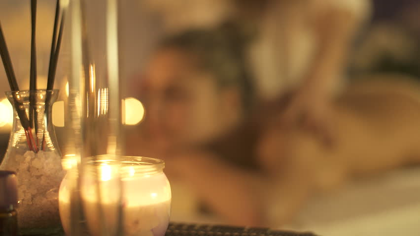 Massage concept. Beautiful young woman reciving relxing massage | Shutterstock HD Video #1026016466