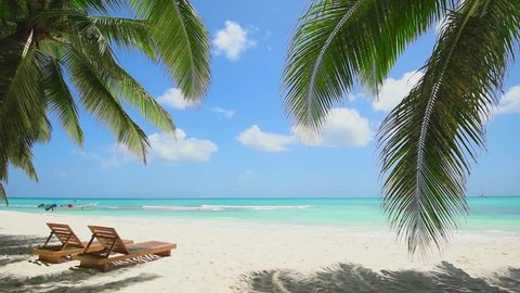Maldives journey trip beach. Blue ocean white sand beach Tropical palms Island paradise. Caribbean sea and sky. Small wild beach chairs. landscape Island. Palms turquoise sea background Atlantic ocean