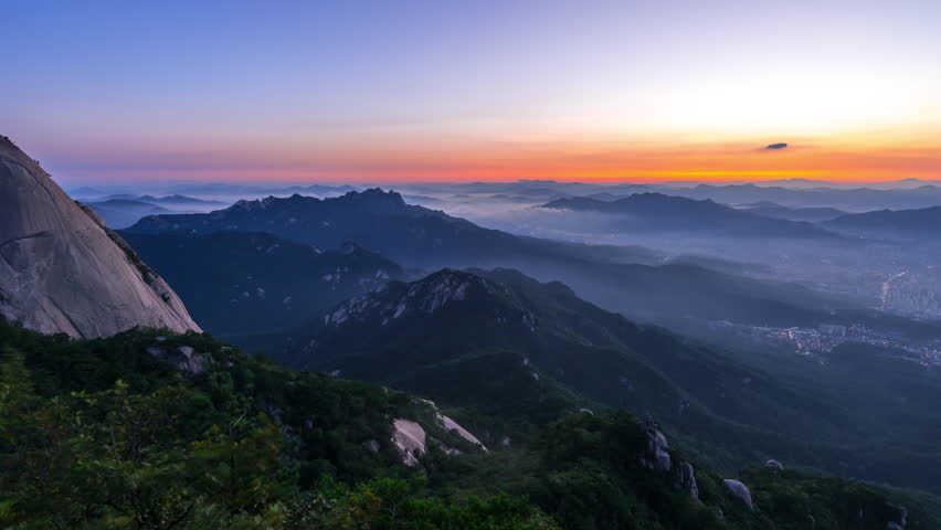 Time Lapse of Sunrise in the foggy at Bukhansan mountain in South Korea. | Shutterstock HD Video #1026110306