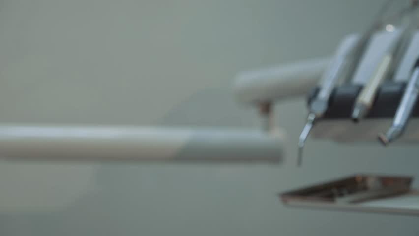 Close-up dentist equipment at camera. 4K.   Shutterstock HD Video #1026121916