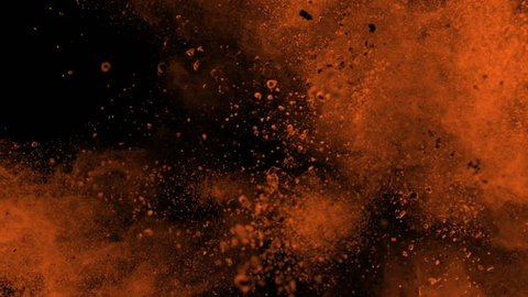 Super slowmotion shot of golden powder explosion isolated on black background.