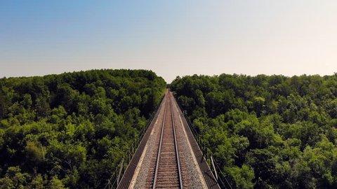 Sandstone, Minnesota / United States - 07 28 2018: Historic Pratt Truss railroad bridge spanning the Kettle River in Minnesota