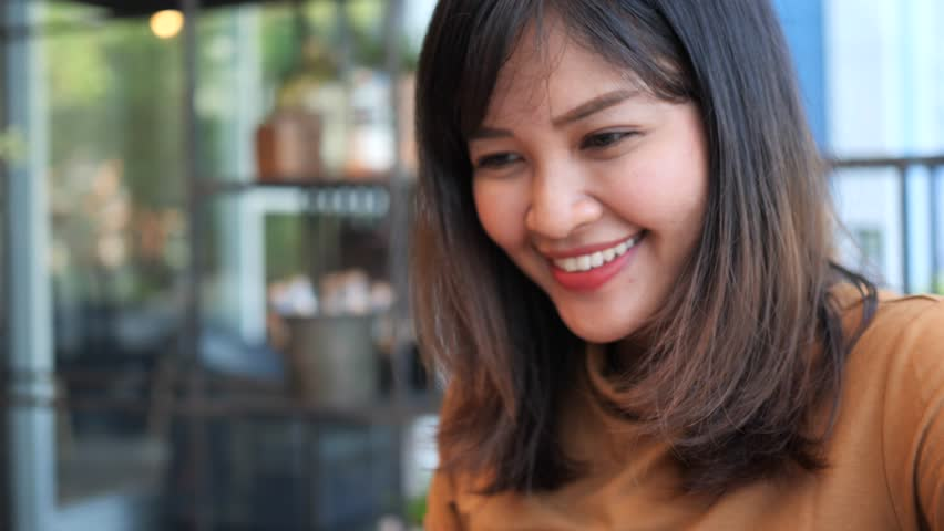 Asian woman using mobile phone happy and smile | Shutterstock HD Video #1026133976