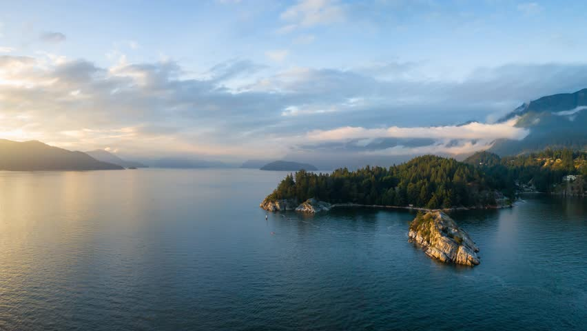 Aerial view of a beautiful Canadian Landscape during a cloudy summer sunset. Taken in Whytecliff Park, Horseshoe Bay, North Vancouver, BC, Canada. Still Image Continuous Animation | Shutterstock HD Video #1026176216
