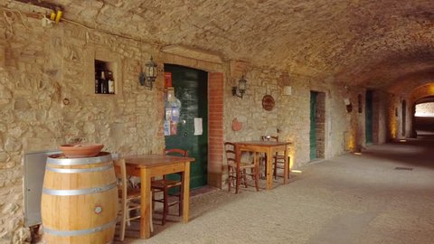 Castellina in Chianti, IT - Mar 2019: Alley of this typical comune in the province of Siena, Tuscany. It is known worldwide for the wine produced in and named for the region, Chianti.