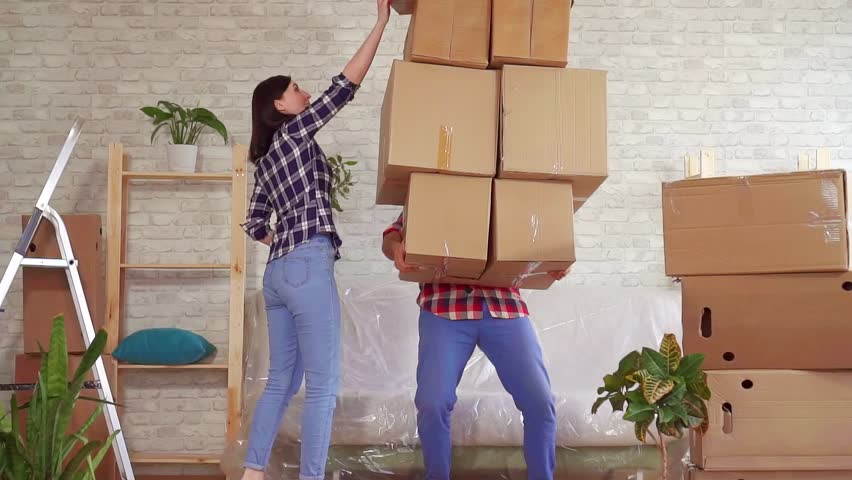 Fale man falls with boxes, problems when moving to a new apartment slow mo | Shutterstock HD Video #1026227366