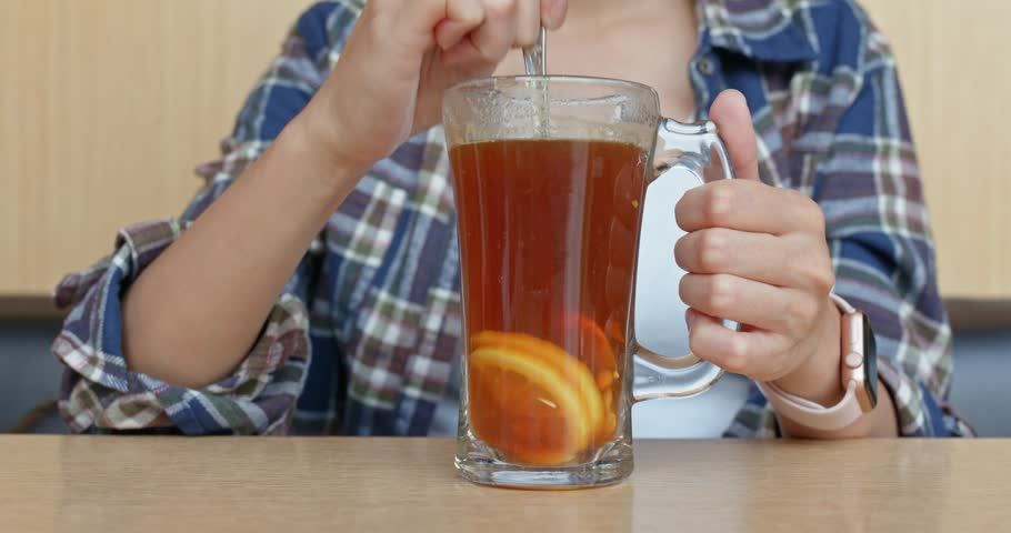 Woman drink of lemon tea in restaurant