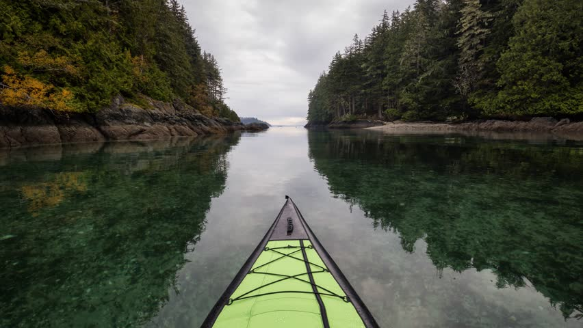 Kayaking on an inflatable kayak in the peaceful ocean by rocky islands near Port Hardy, Vancouver Island, British Columbia, Canada. Still Image Continuous Animation - Cinemagraph | Shutterstock HD Video #1026299966