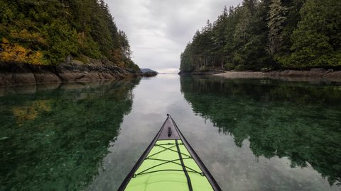 Kayaking on an inflatable kayak in the peaceful ocean by rocky islands near Port Hardy, Vancouver Island, British Columbia, Canada. Still Image Continuous Animation - Cinemagraph