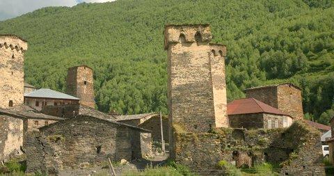 Pan across wide of the stone medieval fortified Svaneti tower houses of  Ushguli, Upper Svaneti, Samegrelo-Zemo Svaneti, Mestia, Georgia.