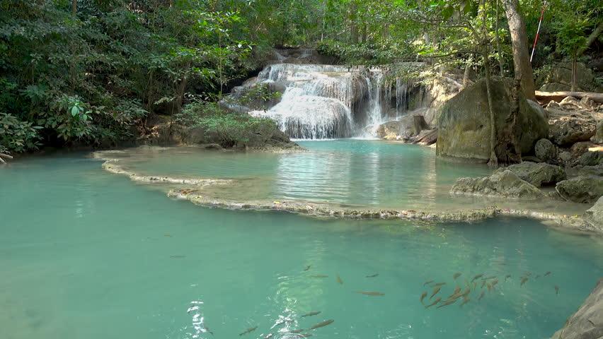 Erawan Waterfall tier 1 with fish in pond, in National Park at Kanchanaburi, Thailand