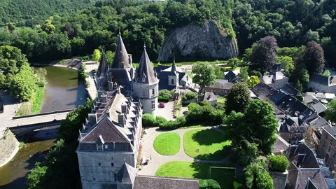 Aerial 4K footage, over the valley, where Durbuy Castle is located. Belgium, province of Luxembourg in the Wallonia region. Beautiful landscape with river, sunny weather during summer season.