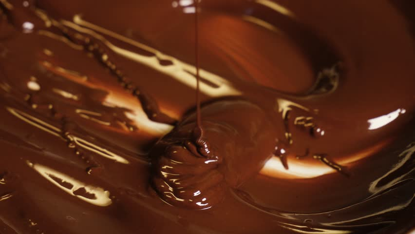 Melted premium dark chocolate flows #1026395516