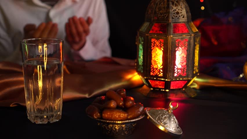 Fasting during Ramadan. Breaking the fast. Religious muslim man praying | Shutterstock HD Video #1026463496