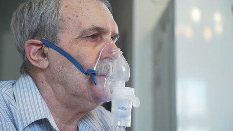 Elderly Man Making Inhalation with Nebulizer