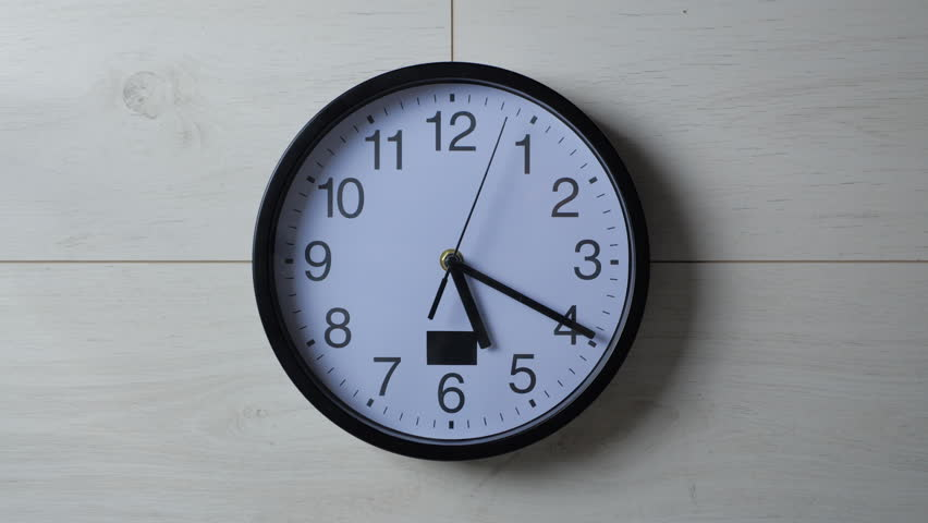 Clock ticking on the wallpapered wall   Shutterstock HD Video #1026541196