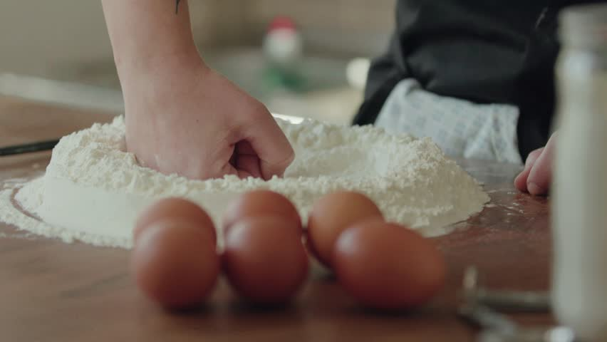 Chef making a well in the flour, 4k slow motion    Shutterstock HD Video #1026553346