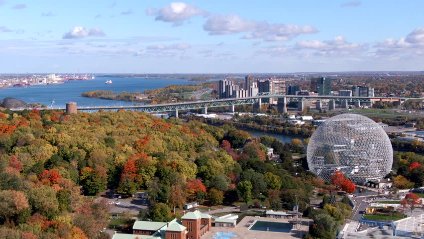Aerial view of Montreal cityscape showing the Biosphere Environmental Museum and maple trees changing colour during Fall season in Quebec, Canada.  | Shutterstock HD Video #1026556526