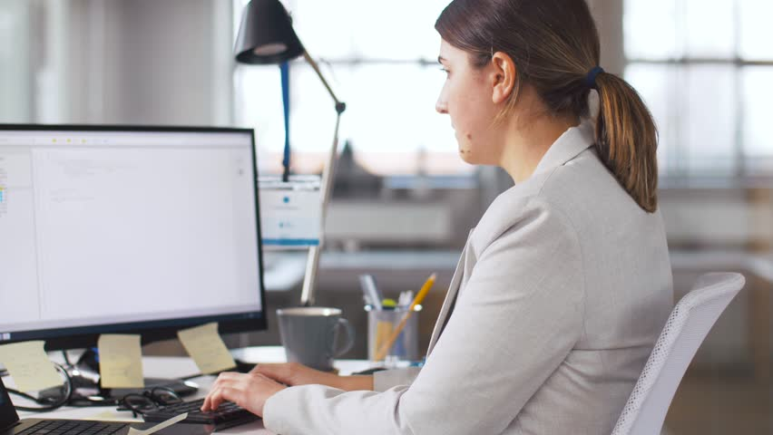 Business, programming and technology concept - female programmer with computer working and taking folder from her colleague at office | Shutterstock HD Video #1026569966