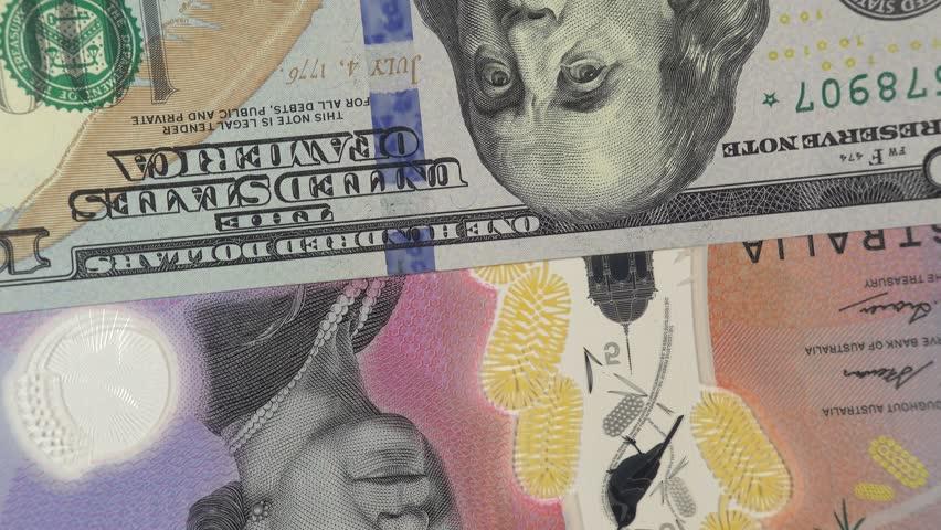 Australia dollar against US dollar bill rotating. Australia and USA trade. 4K stock video footage   Shutterstock HD Video #1026652586