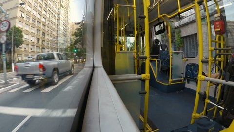 Sao Paulo, Brazil, December 05, 2018. time lapse of traffic and passengers embark and pay their tickets at the ratchet in the interior of a bus in the center of Sao Paulo