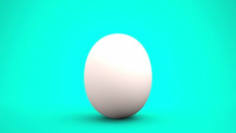 Hatching egg of white eggshell splitting after swaying, isolated on blue green background. Hope coming out concept.
