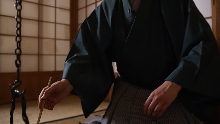 Japanese tea ceremony, the Way of Tea. Tea master pours water into a cup (chawan) | Shutterstock HD Video #1026781796