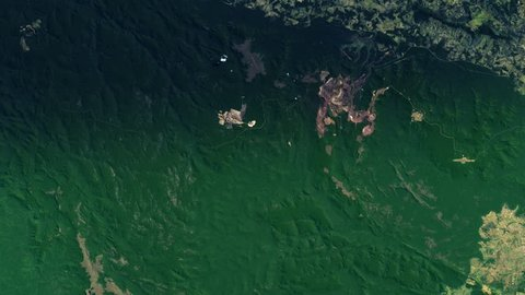 Iron mine in green amazon rainforest satellite view night to day sunrise in Carajas Brazil. Contains public domain image by Nasa