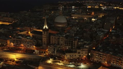 Aerial night view of Valletta city and church in 4K. Malta country