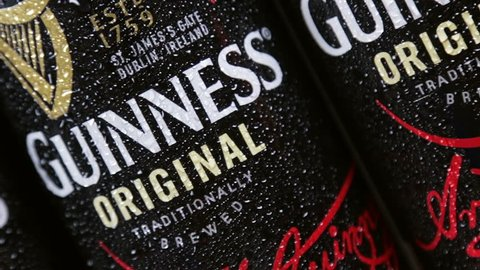 Moscow, Russia - March 28, 2019: logo on aluminum cans of Guinness beer. Guinness beer brand, originally belonged to the Irish company Arthur Guinness Son&Co, founded in 1759 by the brewer Arthur