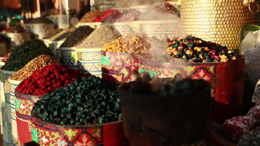 Slowmotion shot of different spices and flavours on a market.