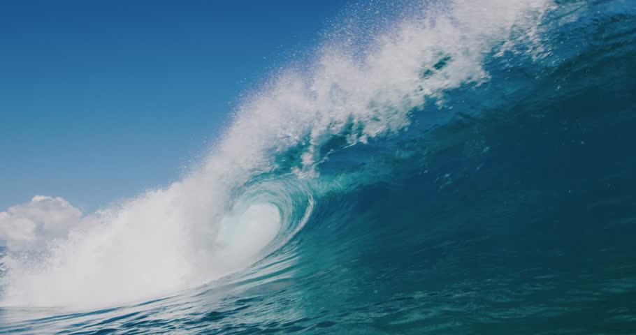 Powerful ocean wave breaking, deep blue wave barrel in warm tropical waters, blue planet | Shutterstock HD Video #1027016186