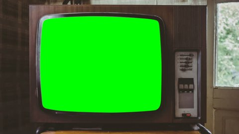 Switch on tuning Retro or Vintage TV or television with green screen 60 fps