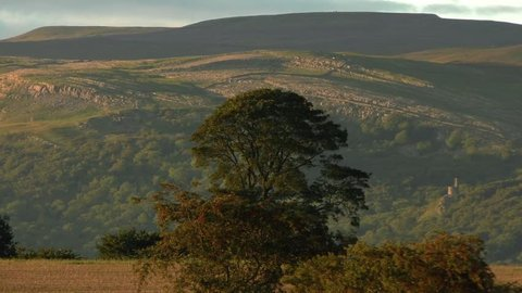 Panning shot of the North Pennines in Cumbria highlighted by the evening light.