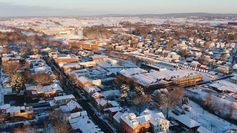 Beautiful high aerial view of sunrise in Lititz county, freshly fallen snow covering town. Pennsylvania
