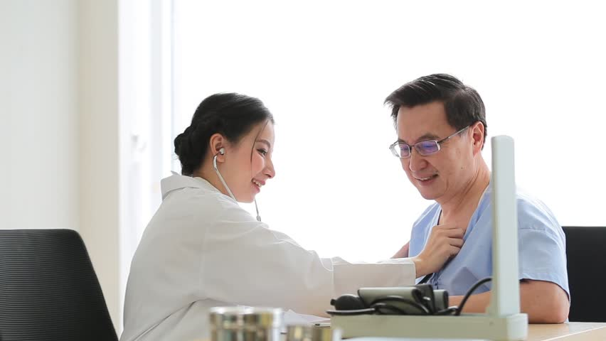 Old patient man talking with medical Doctor woman in office | Shutterstock HD Video #1027240796