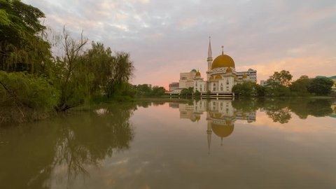 Beautiful sunrise time lapse at a Royal City Mosque in Klang, Selangor, Malaysia with reflection.