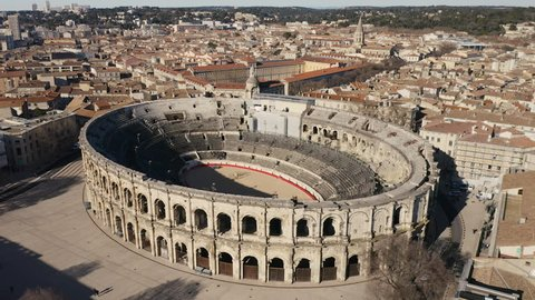 Aerial back traveling over the Arena of Nîmes is a Roman amphitheatre sunny day winter