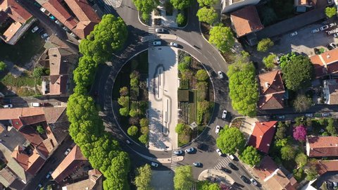 Roundabout with traffic aerial vertical drone shot Nîmes Jean jaures avenue spring time sunny day