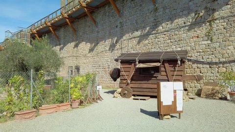 Siena, Italy: Main entrance of medieval village of Monteriggioni within the defensive walls in Tuscany; architecturally significant, referenced in Dante Alighieri's Divine Comedy
