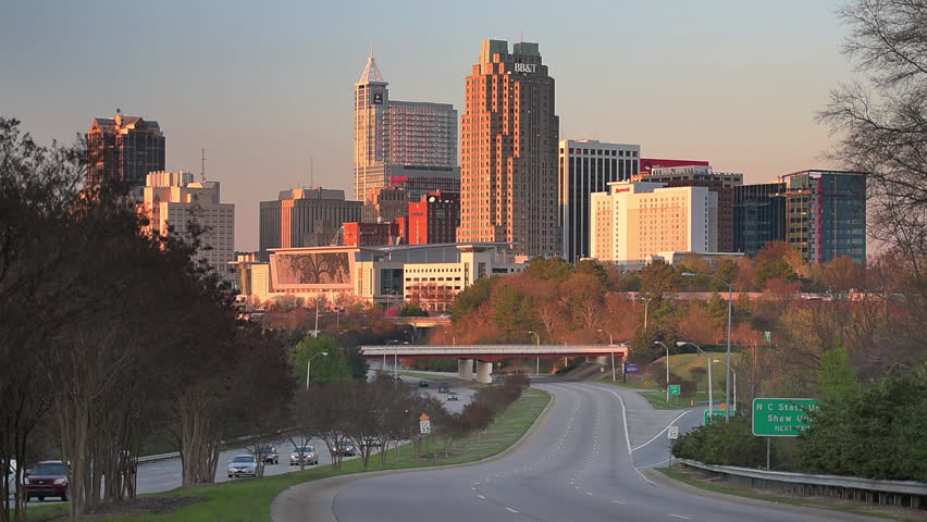 RALEIGH, NORTH CAROLINA - MARCH 30, 2015: Traffic flows into the Raleigh downtown skyline. Raleigh is the state capital of North Carolina.