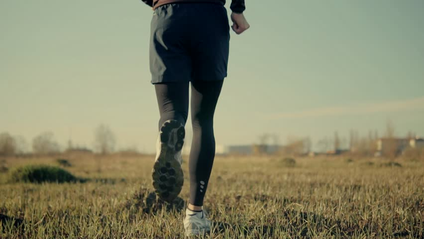 Man Running Slow Motion On Field.Close Up Foot And Running Shoes.Runner Legs Close-Up Jogging In Slow Motion.Male Workout For Marathon Race.Man Athlete Legs Jogging Back View.Sport ,Recreation Concept | Shutterstock HD Video #1027360616