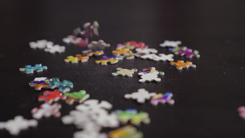 Jigsaw Puzzle Pieces Falling