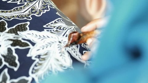 Close up, creating Batik traditionally hand made in Yogyakarta city.