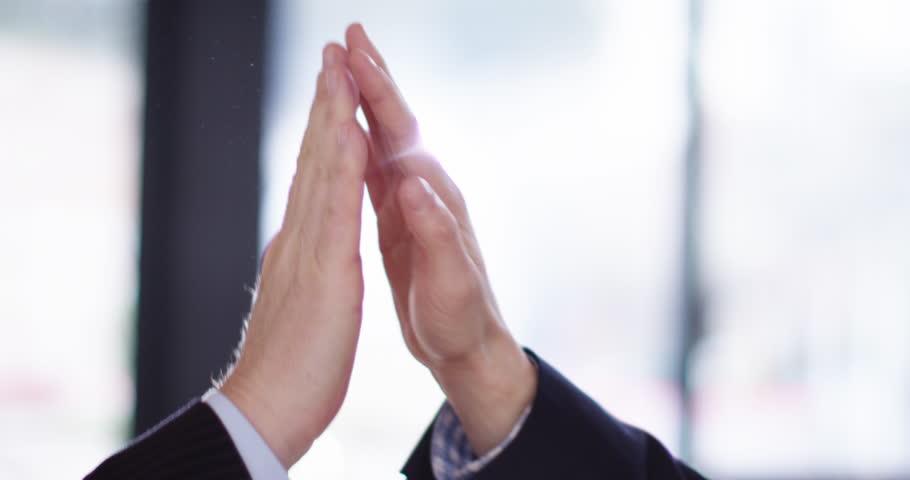 4K Business teamwork concept, close up on hands of man & woman giving a high five. Slow motion. | Shutterstock HD Video #1027405586