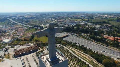 Lisbon / Portugal - March 22 2019: Aerial view of the King Jesus (Cristo Rei) statue, big catholic monument in Lisbon, Portugal.