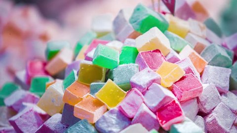 Footage of tasty turkish delight desserts on sale in store in Istanbul.Sweet Turkey dessert food in close up. Delicious exotic lokum dish for snack