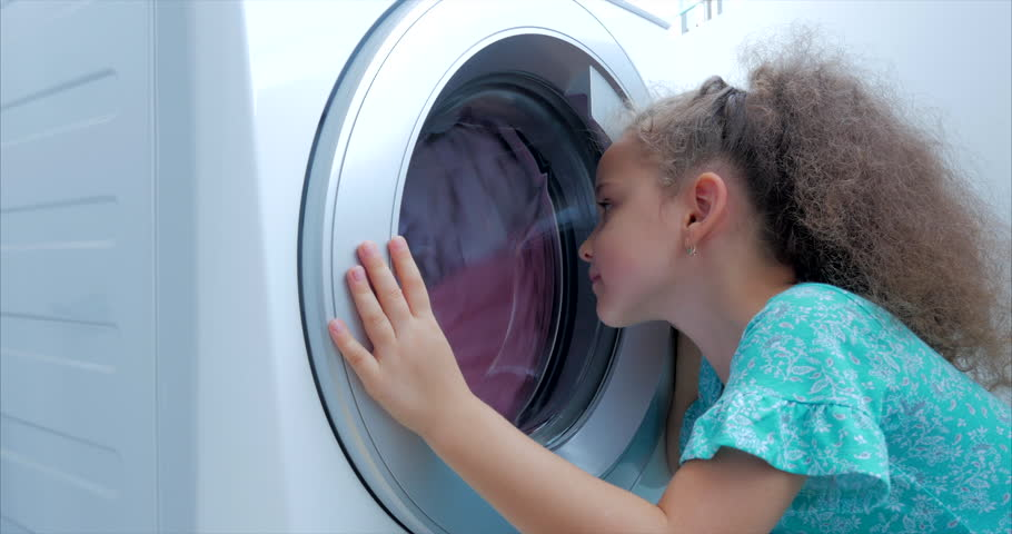 Close Up Cute Child Looks Inside the Washing Machine. Cylinder Spinning Machine. Concept Laundry Washing Machine, Industry Laundry Service. | Shutterstock HD Video #1027555826