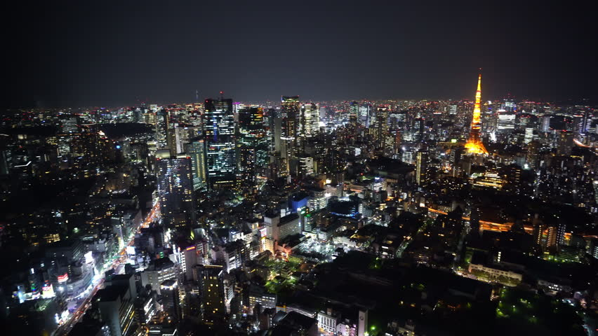 panning shot of Tokyo city at night, Japan