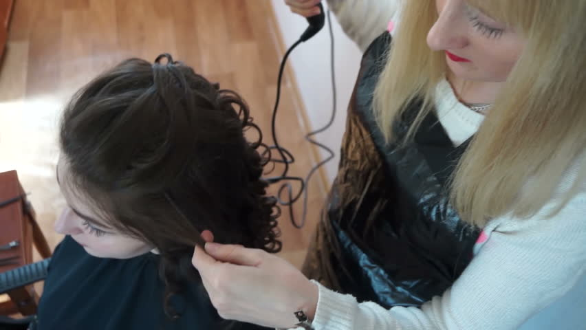 Hairdresser works with hair Curling | Shutterstock HD Video #1027617086